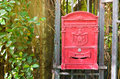 English red mailbox hang on gate traditional Royalty Free Stock Photography