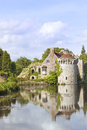 English romantic castle with reflections in water Royalty Free Stock Photo