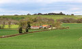 English rural landscape in the chiltern hills with farm in the background farmhouse and fields uk Royalty Free Stock Image