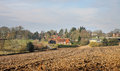 An english rural landscape in the chiltern hills with ploughed field and hamlet Royalty Free Stock Photo