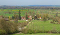 An english rural landscape with hamlet a in oxfordshire fields and meadows the of little wittenham in the distance Royalty Free Stock Images