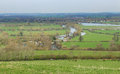 An english rural landscape with hamlet a in oxfordshire the river thames and the village of dorchester in the distance Stock Photo