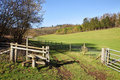 English Rural Landscape with Stile by a Farm Track Stock Image