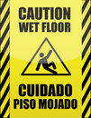 English and Spanish wet floor sign Stock Photos