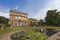 English stately home and gardens large old mansion house with landscaped a sculpture Stock Images