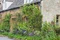 English stone house with colourful cottage front garden Royalty Free Stock Photo