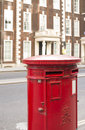 English style mailboxes red mailboxe and vintage buildings Royalty Free Stock Photo