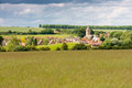 English summer landscape village church surrounded by trees in bedfordshire great britain with a meadow in the foreground Stock Photos