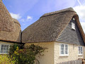 English thatched cottage photo of an pretty year old located in rural kent photo taken april Stock Photography