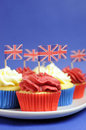 English theme red white and blue cupcakes with great britain union jack flags close up vertical for national party celebrations Stock Image