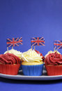 English theme red white and blue cupcakes with great britain union jack flags vertical with copy space for national party Stock Photo