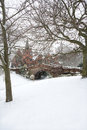 English village bridge in winter snow. Royalty Free Stock Images