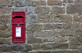 English village post box set into stone wall winderton warwickshire england Royalty Free Stock Photo