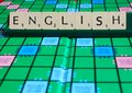 English word on scrabble for use with designs Royalty Free Stock Photo