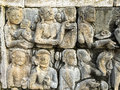Engraved figures depicts the story of Buddha on a stone wall of Borobudur, Indonesia Royalty Free Stock Photo
