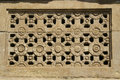 Engraved flower pattern stone window ladakhan temple aihole near bagalkot karnataka india asia Stock Images