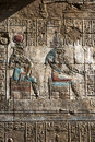 An engraved relief and hieroglyphs at the Temple of Horus at Edfu in Egypt. Royalty Free Stock Photo