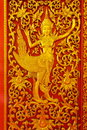 Engraving idol of angel from thai fairy for door or entrance into inside buddhist church Stock Photo