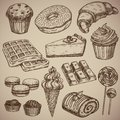 Engraving a sweet set: muffin, donut, croissant, waffles, cheesecake, capcake, macaroons, chocolate bar, two chocolate