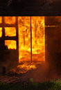 Engulfed in flames part of house from real world fire Royalty Free Stock Image