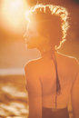 Engulfed by sunlight a woman surrounded an orange light Stock Photo