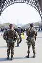 Enhanced security of military forces paris france march under eiffel tower in paris Stock Photos