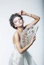 Enigma. Fantasy. Retro fashion woman, vintage fan Royalty Free Stock Photo