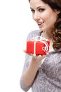 Enigmatic young woman hands gift wrapped red paper isolated white Royalty Free Stock Photo