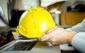 Enigneer is holding yellow safty work helmet Royalty Free Stock Photo