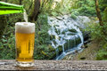 Enjoy beer with nice view waterfall landscape Stock Photo