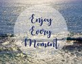 Enjoy every moment.Inspirational quote on beautiful ocean view background. Royalty Free Stock Photo