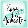 Enjoy every moment. Modern brush calligraphy. Handwritten ink lettering. Hand drawn design elements. Motivation quote.