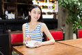 Enjoy the good times beautiful chinese female student alone to a time drinking coffee Stock Photo