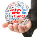 Enjoy little things hand take transparet ball with wordcloud and red inscription Royalty Free Stock Photos