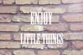 Enjoy the little things message on wall Stock Image