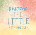Enjoy the little things quote typographical over colorful bokeh lights background Royalty Free Stock Photos
