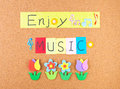 Enjoy music conceptual words with decoration on cork Royalty Free Stock Photos