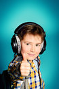 Enjoy music cute year old boy listening to on headphones Royalty Free Stock Photo