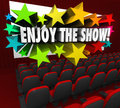 Enjoy the show movie theater screen entertainment fun words on a in a to tell audience to sit back and be entertained by a film or Stock Image