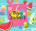 Enjoy Summer lettering on blue wooden background.