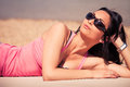 Enjoy in sun young woman with sunglasses on beach summer day Royalty Free Stock Photography