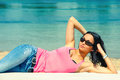 Enjoy in sun young woman with sunglasses and casual clothes on beach summer day Royalty Free Stock Image