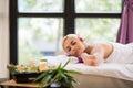 Enjoying aromatherapy pretty woman in spa salon Royalty Free Stock Photos