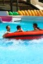 Enjoying  the big float slide. Royalty Free Stock Photo