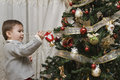 Enjoying with the Christmas tree. Stock Images