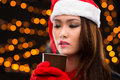 Enjoying coffee close up image of a young woman in a santa hat with cinnamon Royalty Free Stock Photos
