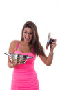 Enjoying cooking pretty girl holding a pot in her hand with reaction Royalty Free Stock Image