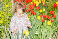 Enjoying flower baby playing woth in garden Stock Photos