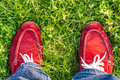 Enjoying free day outdoors wearing red shoes standing on green lawn in the country freedom happiness Royalty Free Stock Photos