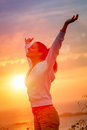 Enjoying freedom and life on sunset woman beautiful magical blissful girl raising arms feeling free relaxed happy Stock Photos